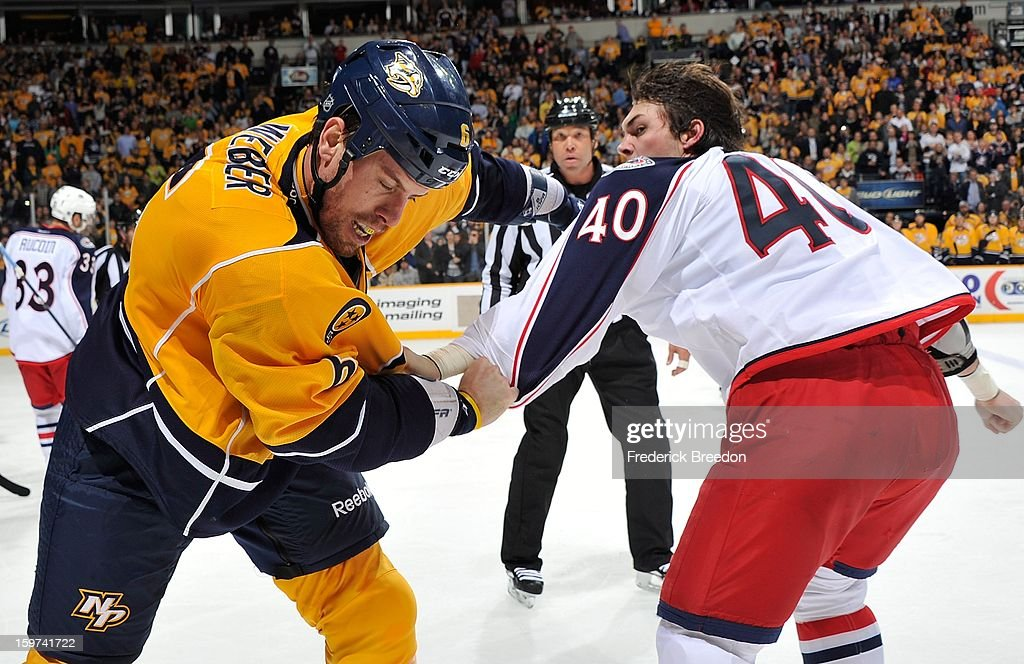 <a gi-track='captionPersonalityLinkClicked' href=/galleries/search?phrase=Shea+Weber&family=editorial&specificpeople=554412 ng-click='$event.stopPropagation()'>Shea Weber</a> #6 of the Nashville Predators fights <a gi-track='captionPersonalityLinkClicked' href=/galleries/search?phrase=Jared+Boll&family=editorial&specificpeople=2238879 ng-click='$event.stopPropagation()'>Jared Boll</a> #40 of the Columbus Blue Jackets at Bridgestone Arena in their season opener on January 19, 2013 in Nashville, Tennessee.
