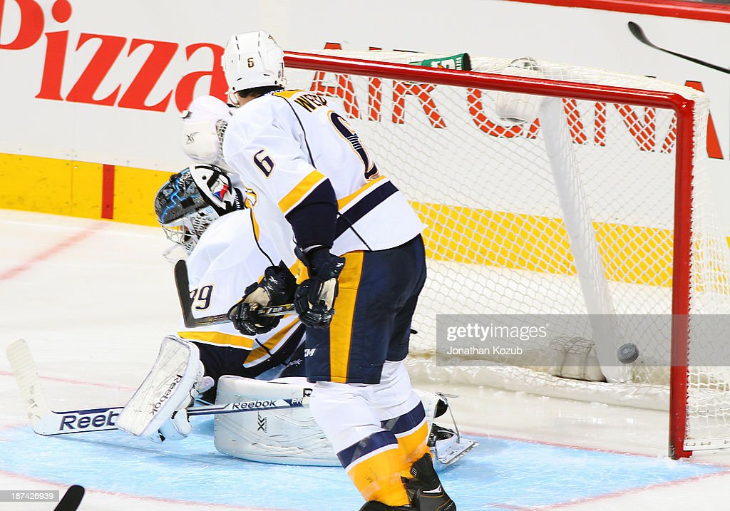 <a gi-track='captionPersonalityLinkClicked' href=/galleries/search?phrase=Shea+Weber&family=editorial&specificpeople=554412 ng-click='$event.stopPropagation()'>Shea Weber</a> #6 of the Nashville Predators looks towards the net as the puck gets behind goaltender Marek Mazanec #39 on a shot by Bryan Little #18 (not shown) of the Winnipeg Jets for a third period goal at the MTS Centre on November 8, 2013 in Winnipeg, Manitoba, Canada.