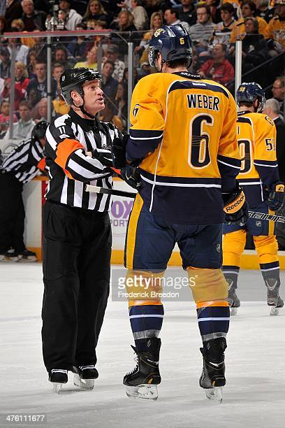 Shea Weber of the Nashville Predators speaks to referee Kelly Sutherland during a game against the Winnipeg Jets at Bridgestone Arena on March 1 2014...