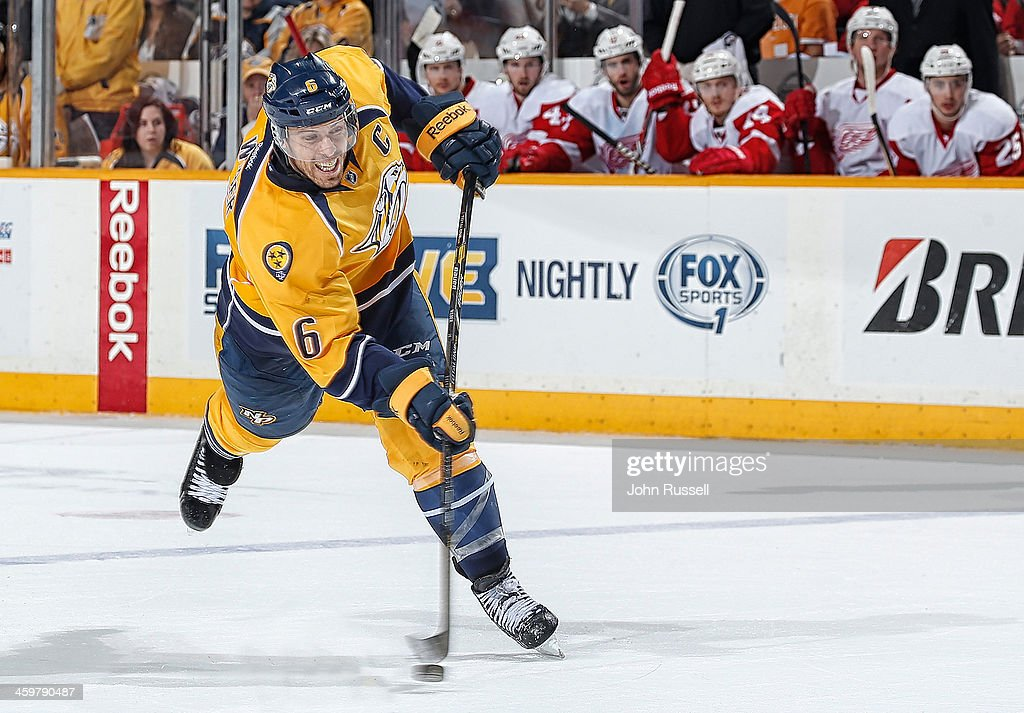 <a gi-track='captionPersonalityLinkClicked' href=/galleries/search?phrase=Shea+Weber&family=editorial&specificpeople=554412 ng-click='$event.stopPropagation()'>Shea Weber</a> #6 of the Nashville Predators takes a slapshot against the Detroit Red Wings at Bridgestone Arena on December 30, 2013 in Nashville, Tennessee.
