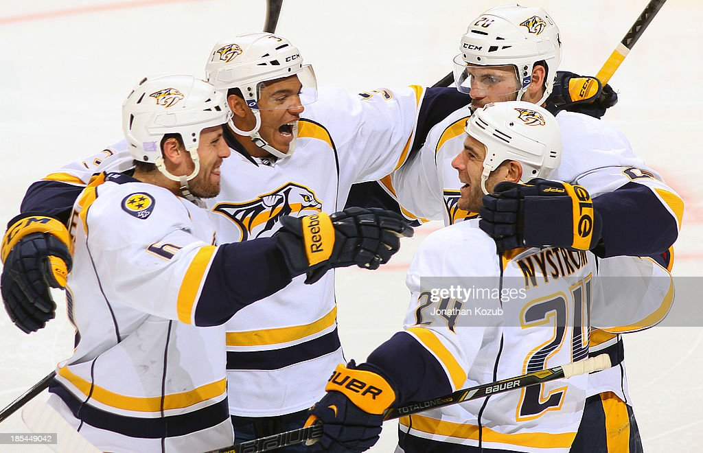 <a gi-track='captionPersonalityLinkClicked' href=/galleries/search?phrase=Shea+Weber&family=editorial&specificpeople=554412 ng-click='$event.stopPropagation()'>Shea Weber</a> #6, Seth Jones #3, <a gi-track='captionPersonalityLinkClicked' href=/galleries/search?phrase=Eric+Nystrom&family=editorial&specificpeople=2209813 ng-click='$event.stopPropagation()'>Eric Nystrom</a> #24 and <a gi-track='captionPersonalityLinkClicked' href=/galleries/search?phrase=Paul+Gaustad&family=editorial&specificpeople=577980 ng-click='$event.stopPropagation()'>Paul Gaustad</a> #28 of the Nashville Predators celebrate a shorthanded goal during second period action against the Winnipeg Jets at the MTS Centre on October 20, 2013 in Winnipeg, Manitoba, Canada.