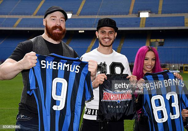 Sheamus Mauro Icardi of FC Internazionale and Sasha Banks pose for a photo at Stadio Giuseppe Meazza on April 13 2016 in Milan Italy