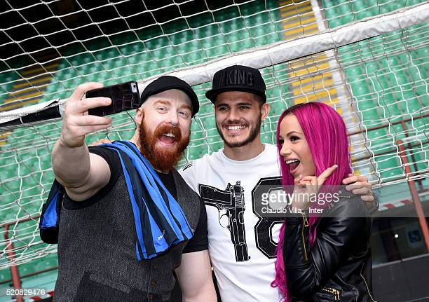 Sheamus Mauro Icardi of FC Internazionale and Sasha Banks pose for a selfie at Stadio Giuseppe Meazza on April 13 2016 in Milan Italy