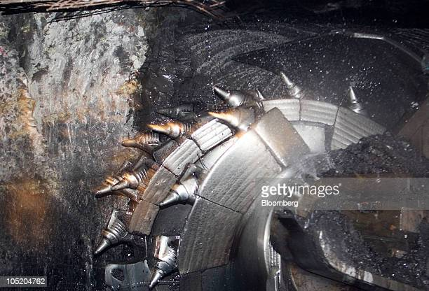 A shearer cuts away coal from in Foresight Energy LLC's Pond Creek longwall coal mine in Johnson City Illinois US on Monday June 21 2010 In 2002...
