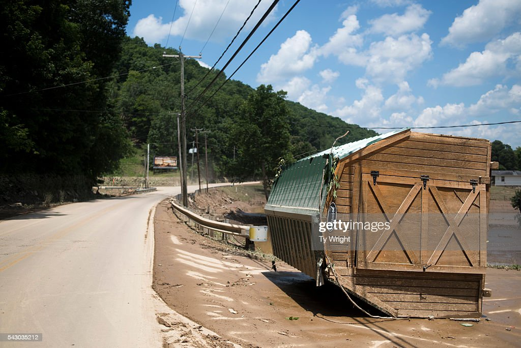 A shed lies on it's side along State Route 119 left over from flooding, June 25, 2016 in Falling Rock, West Virginia. The flooding of the Elk River claimed the lives of at least 23 people in West Virginia.