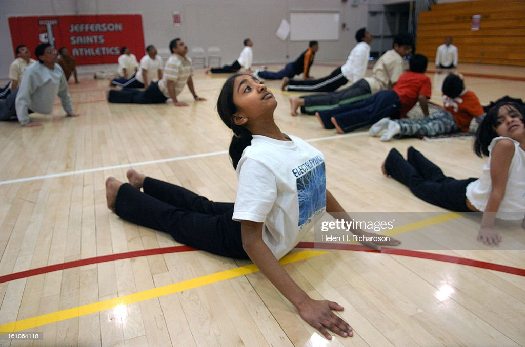 Sheela Kailasam <cq> 12 <cq> right follows along in the Sun Salutation held in the gym at Jefferson High School in Edgewater <cq> About 75 people...