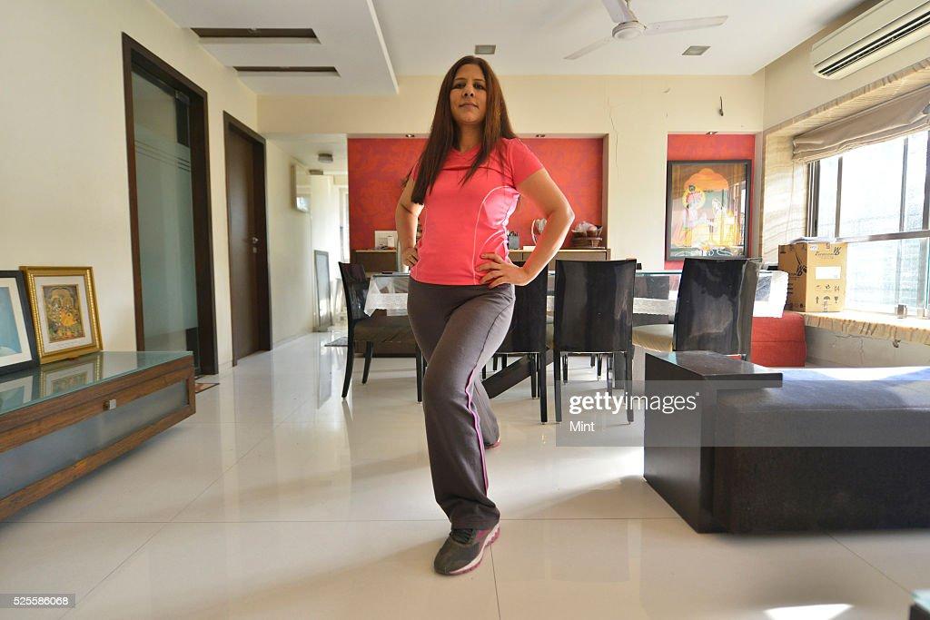 Sheela Tanna, Aerobics Trainer, shows few exercises at home on May 13, 2015 in Mumbai, India.