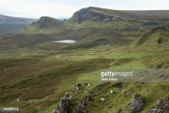 Sheep graze near Quiraing mountain on October 5 2013 near Staffin Isle of Skye Scotland The Isle of Skye is a popular tourist destination