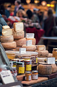 Sheep milk cheeses for sale at market. Also honey, pickles and other preserved items.
