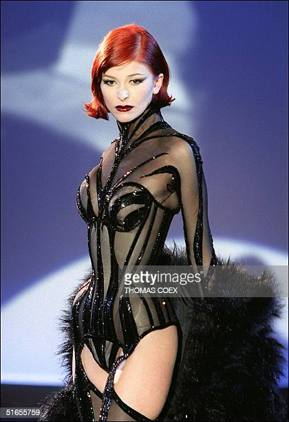 A sheer black tigerstripe body suit with high collar and matching furry shawl by Thierry Mugler for his 1998/99 Fall/Winter haute couture collection...