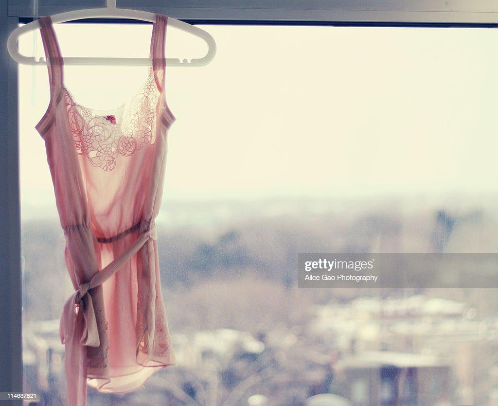 Sheer pink blouse hanging