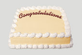 Sheet cake with congratulations written on it