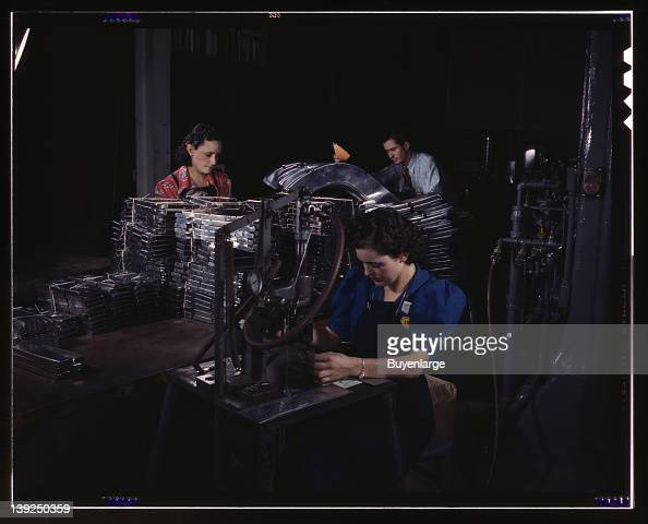 Sheet metal parts are numbered with this pneumatic numbering machine in North American's sheet metal department North American Aviation Inc Inglewood...