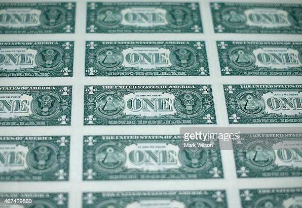 A sheet of freshly printed one dollar bills is ready for inspection at the Bureau of Engraving and Printing on March 24 2015 in Washington DC The...