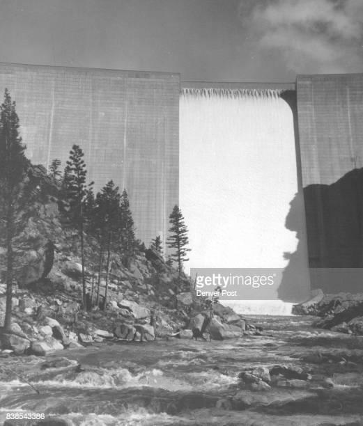 Sheet Of Water leaves Goss Reservoir A sheet of foamy waters spills down the face of Denver's Gross Reservoir dam and into South Boulder Creek Monday...