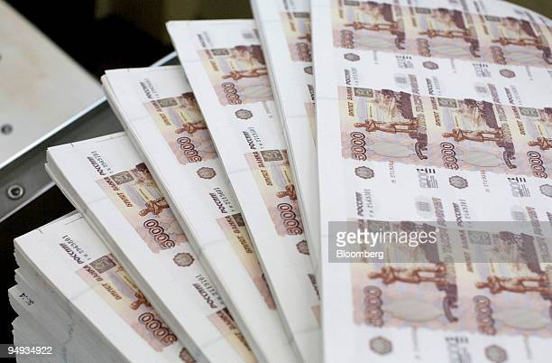 Sheets of 5000 denomination ruble bank notes sit on a table at the Goznak mint in Moscow Russia on Wednesday Dec 24 2008 Russia's ruble slid to the...