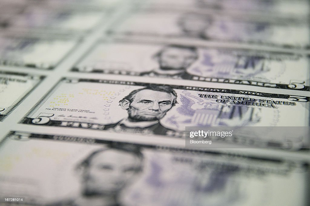 Sheets of five dollar notes sit on a pallet before being printed with a serial number at the Bureau of Engraving and Printing in Washington, D.C., U.S., on Tuesday, April 23, 2013. Stocks rallied amid growth in U.S. home sales, better-than-forecast earnings and speculation the European Central Bank will cut interest rates. U.S. equities recovered after briefly erasing gains following a false report of explosions at the White House. Photographer: Andrew Harrer/Bloomberg via Getty Images
