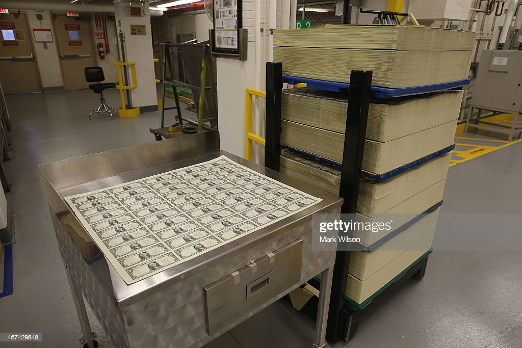 Sheets of freshly printed one dollar bills are ready for inspection at the Bureau of Engraving and Printing on March 24 2015 in Washington DC The...