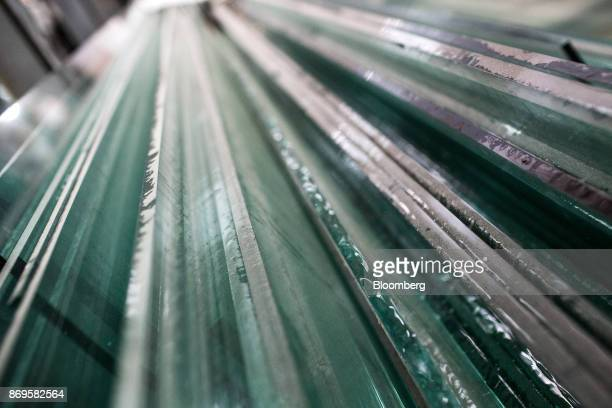 Sheets of glass sit at the Somvang Glass Factory on the outskirts of Vientiane Laos on Wednesday Nov 1 2017 Asia'ssmallest economies aregrowing...