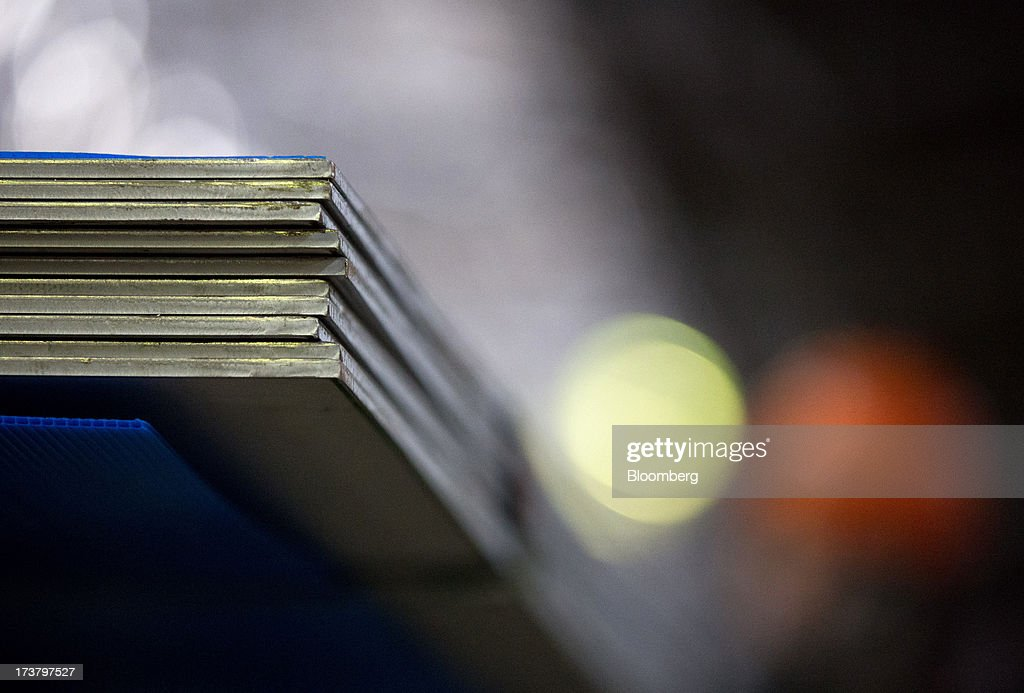 Sheets of steel metal sit in a pile during production at OAO Mechel's metallurgical plant in Chelyabinsk, Russia, on Wednesday, July 17, 2013. Mechel, the country's largest producer of coking coal for steelmakers has begun operating its $700m rail production line which can produce 100 meter rails. Photographer: Andrey Rudakov/Bloomberg via Getty Images