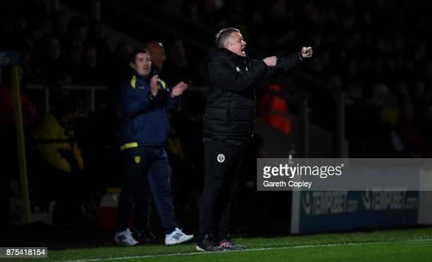 Sheffield United celebrates manager Chris Wilderduring the Sky Bet Championship match between Burton Albion and Sheffield United at Pirelli Stadium...
