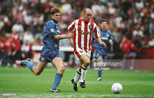 Sheffield United forward Alan Cork outpaces Gary Pallister of Manchester United during the first round of FA Premier League games at Bramall Lane on...