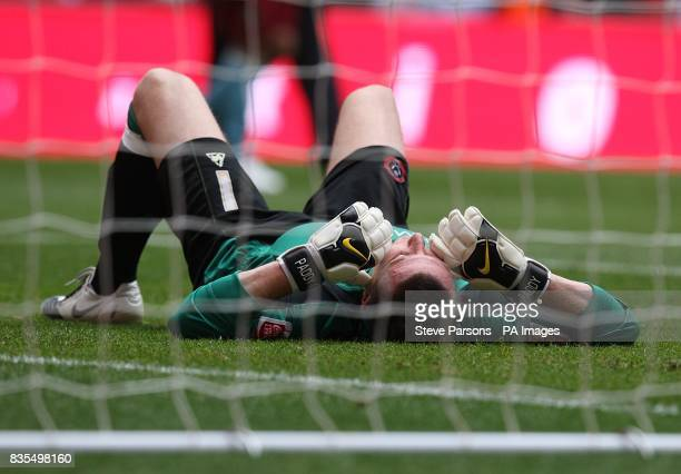 Sheffield United goal keeper Patrick Kenny lays dejected after the match