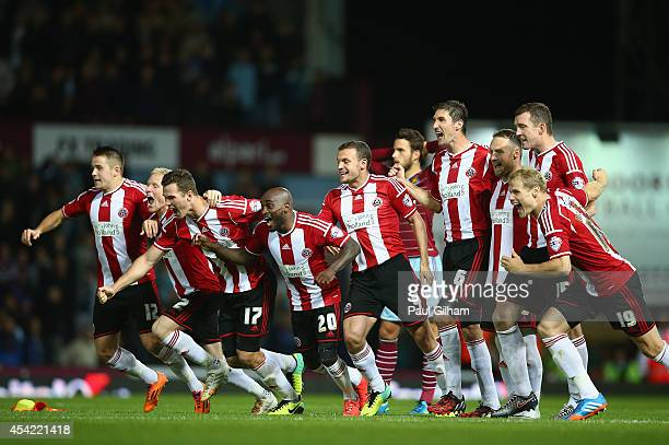 Sheffield United players celebrate after Michael Doyle of Sheffield United scored the winning penalty in a penalty shoot out at the end of the...