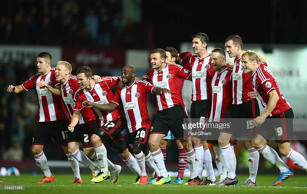 Sheffield United players celebrate after Michael Doyle of Sheffield United scored the winning penalty in a penalty shoot out at the end of the Capital One Cup between West Ham United and Sheffield United at the Boleyn Ground on August 26, 2014 in London, England.