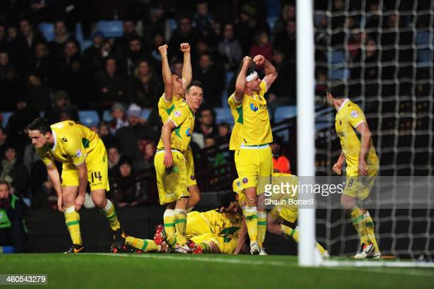 Sheffield United players celebrate the goal scored by Ryan Flynn of Sheffield United during the Budweiser FA Cup third round match between Aston...