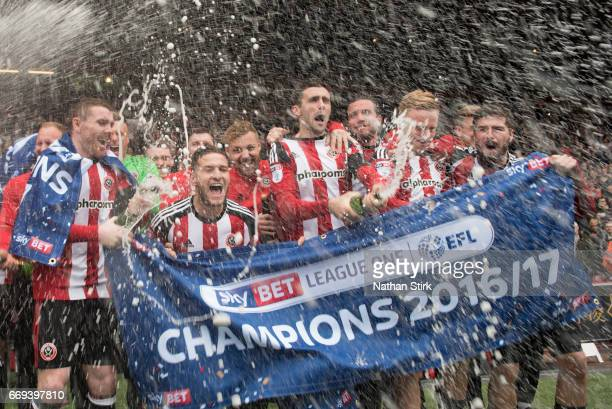Sheffield United players celebrate winning promotion to the Sky Bet Championship after the Sky Bet League One match between Sheffield United and...