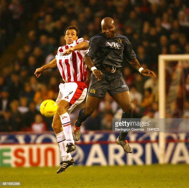 Sheffield United's Ashley Ward and Burnley's Arthur Gnohere battle for the ball
