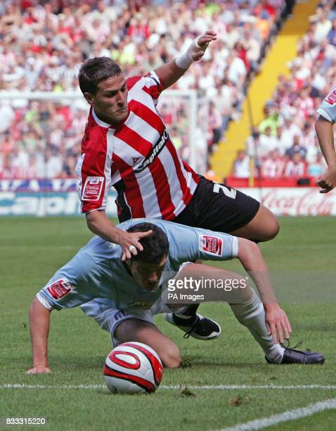 Sheffield United's Billy Sharp runs over Colchester United's Pat Baldwin during the CocaCola Football League Championship match at Bramall Lane...