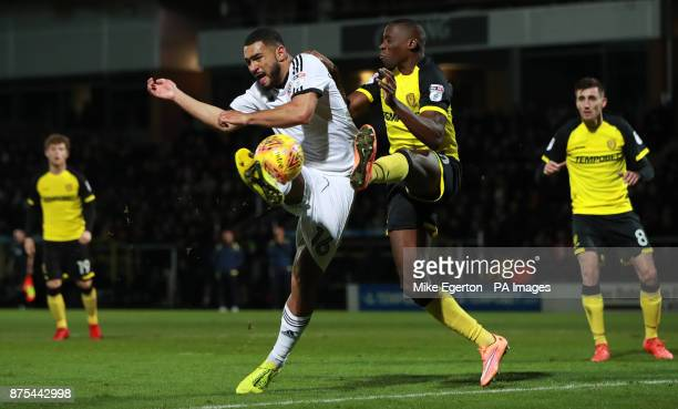 Sheffield United's Cameron CarterVickers has a shot on goal blocked by Burton Albion's Lucas Akins during the Sky Bet Championship match at The...