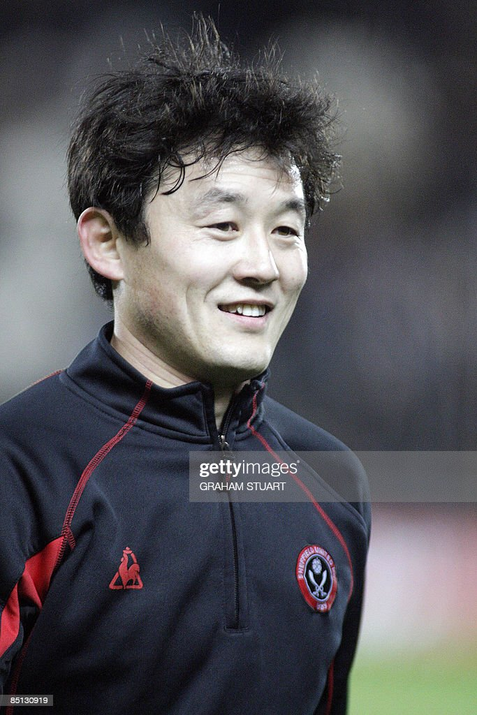 Sheffield United's Chinese defender <a gi-track='captionPersonalityLinkClicked' href=/galleries/search?phrase=Sun+Jihai&family=editorial&specificpeople=228898 ng-click='$event.stopPropagation()'>Sun Jihai</a> smiles before an English FA Cup, fifth round replay, football match with Hull City at the KC Stadium, Kingston upon Hull, England, on February 26, 2009. AFP PHOTO/GRAHAM STUART - FOR EDITORIAL USE ONLY Additional licence required for any commercial/promotional use or use on TV or internet (except identical online version of newspaper) of Premier League/Football League photos. Tel DataCo +44 207 2981656. Do not alter/modify photo.