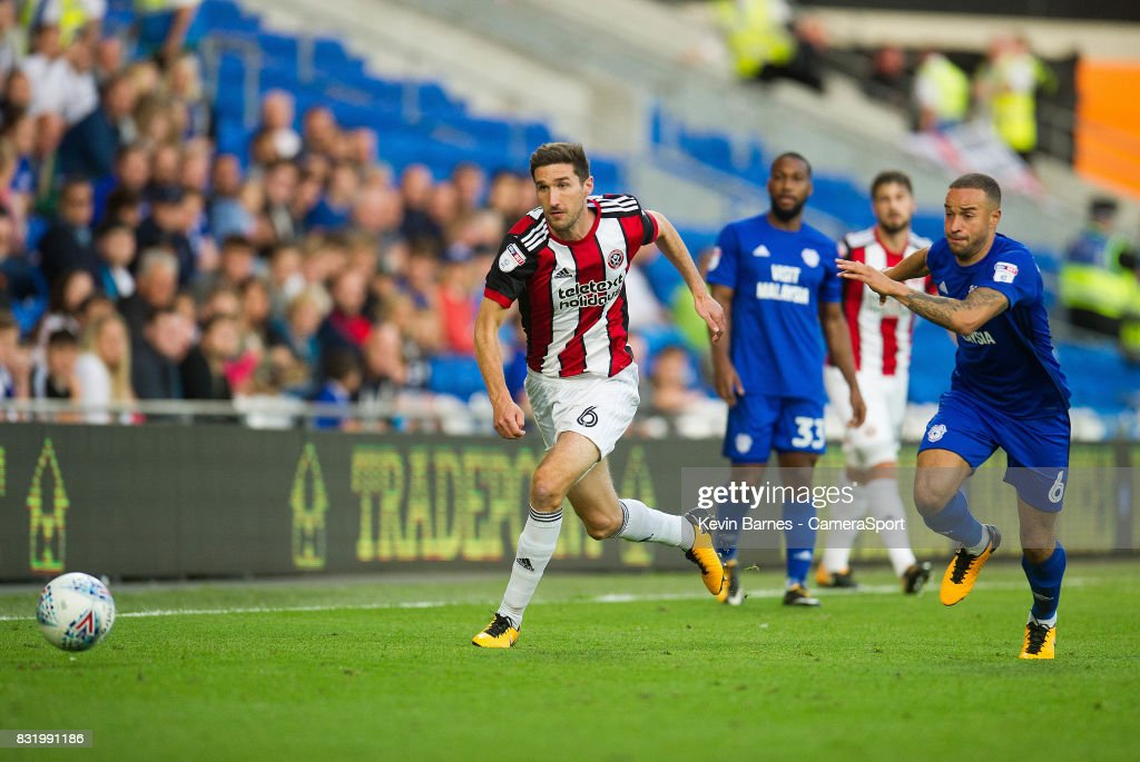 Sheffield United's Chris Basham under pressure from Cardiff City's Jazz Richards during the Sky Bet Championship match between Cardiff City and Sheffield United at Cardiff City Stadium on August 15, 2017 in Cardiff, Wales.