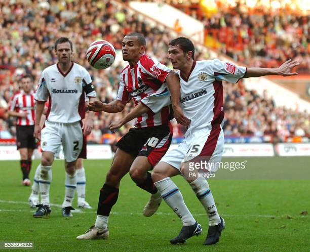 Sheffield United's Danny Webber and Burnley's John Spicer in action during the CocaCola Football Championship match at Bramall Lane Sheffield