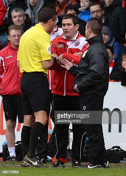 Sheffield United's English manager Nigel Clough is spoken to by referee Andre Marriner during the FA Cup fourth round football match between...