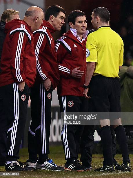 Sheffield United's English manager Nigel Clough speaks to referee Michael Oliver during the English League Cup quarterfinal football match between...