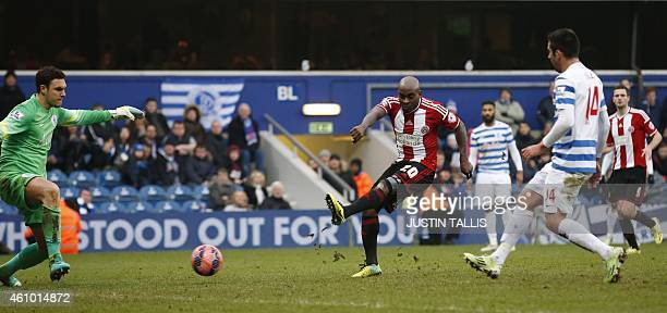 Sheffield United's EnglishJamaican midfielder Jamal CampbellRyce shoots past Queens Park Rangers' English goalkeeper Alex McCarthy to score their...