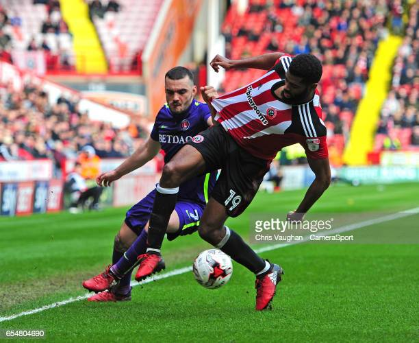 Sheffield United's Ethan EbanksLandell vies for possession with Charlton Athletic's Tony Watt during the Sky Bet League One match between Sheffield...