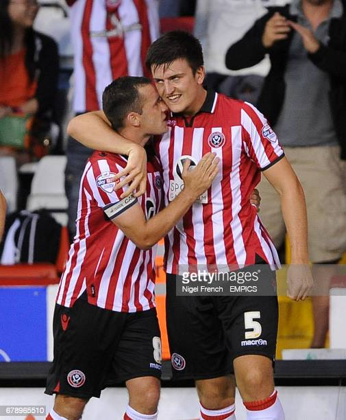 Sheffield United's Harry Maguire celebrates with Michael Doyle after scoring his sides second goal of the game against Notts County