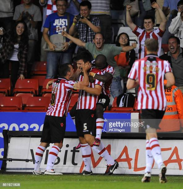 Sheffield United's Harry Maguire celebrates with Michael Doyle and Fabian Brandy after scoring his sides second goal during the Sky Bet League One...