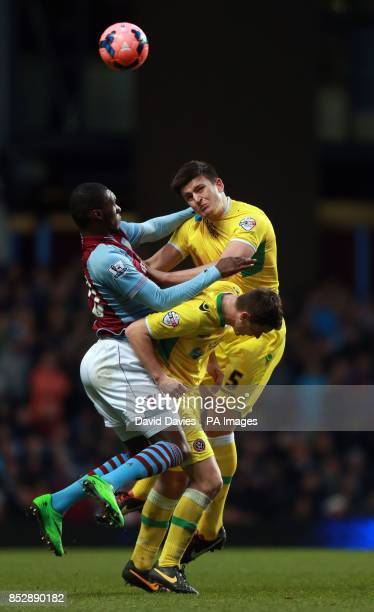 Sheffield United's Harry Maguire wins a header from Aston Villa's Christian Benteke during the FA Cup Third Round match at Villa Park Birmingham