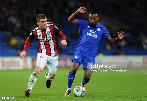 Sheffield United's John Fleck battles with Cardiff City's Loic Damour during the Sky Bet Championship match between Cardiff City and Sheffield United...