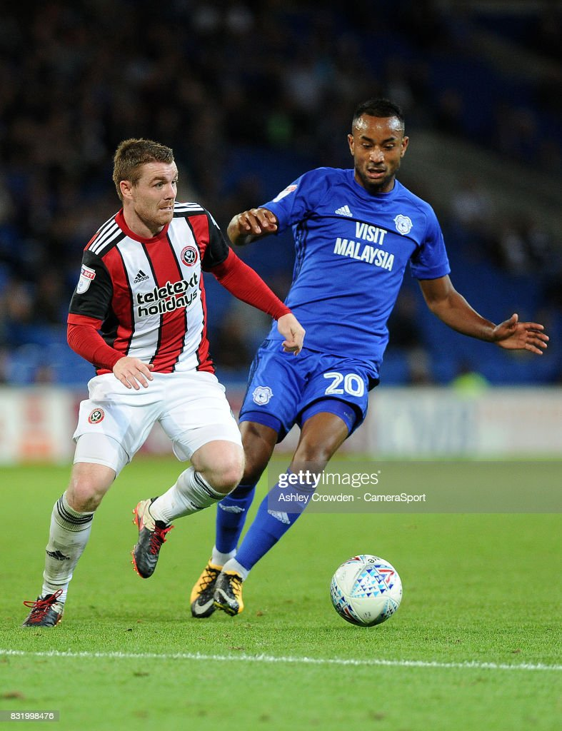 Sheffield United's John Fleck battles with Cardiff City's Loic Damour during the Sky Bet Championship match between Cardiff City and Sheffield United at Cardiff City Stadium on August 15, 2017 in Cardiff, Wales.