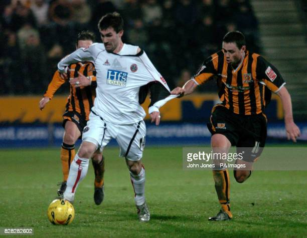 Sheffield United's Keith Gillespie tussles with Hull City's Damien Delaney during the CocaCola Championship match at the Kingston Communications...