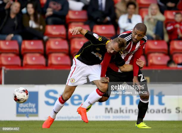 Sheffield United's Leon Clarke and Crewe Alexandra's George Ray battle for the ball