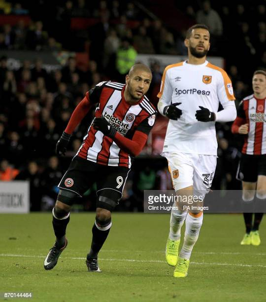 Sheffield United's Leon Clarke celebrates after he scores his sides fourth goal during the Sky Bet Championship match at Bramall Lane Sheffield