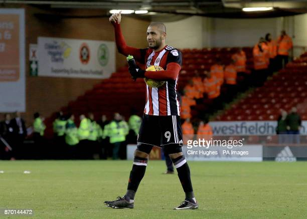 Sheffield United's Leon Clarke celebrates with the matchball at the end of the the Sky Bet Championship match at Bramall Lane Sheffield